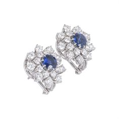 Jewellery / Earrings White Gold Sapphire And Diamond Earrings A pair of 18k white gold sapphire and diamond cluster earrings.… / MAD on Collections - Browse and find over 10,000 categories of collectables from around the world - antiques, stamps, coins, memorabilia, art, bottles, jewellery, furniture, medals, toys and more at madoncollections.com. Free to view - Free to Register - Visit today. #Jewelry #Earrings #MADonCollections #MADonC