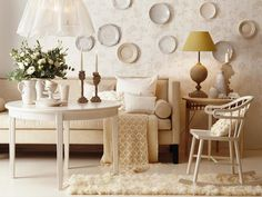 Living Room Designs: White on White    Mixing elements like a fluffy rug, a crocheted throw and shiny plates puts the focus on textures rather than colors.    Similar table: Bellbord dining table, (price available upon request) at Real Gustavian. Astier de Villate pottery, (prices available upon request) at John Derian.
