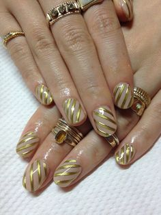 Very sexy and classy gold striped manicure looks great with your gold bling.