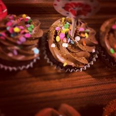 Chocolate cupcakes with chocolate Swiss meringue buttercream and confetti sprinkles!