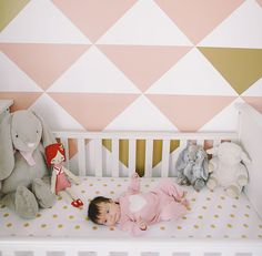 Sienna looks quite comfy in her gold polka-dotted crib sheets. Source: Kristin and Brandon Kidd for Green Wedding Shoes