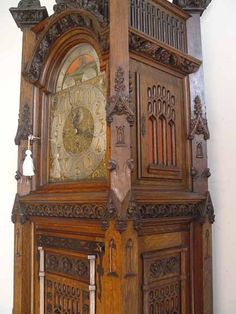 """Northwind Antiques - Victorian Detail Listings - Rare Waltham model c1900. Fantastic Gothic carvings w/ cherub heads and other faces. Nine tube works play three different tunes, Westminster, Whittington, and Oxford. Also has silence lever on dial. Works well and was recently cleaned. Case is in wonderful original finish. Works and tubes signed Waltham. Fine original condition. 105"""" high, 27"""" wide, 20"""" deep. Item # 020912"""