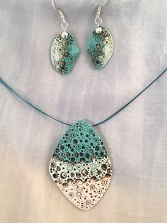 By Debby Wakley Premo polymer clay in gorgeous turquoise tones layered, textured and aged. Inspired by Eva Hascova's Earth Layers work