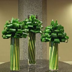 Folded aspisdistra arrangements #green foliage arrangement #greencenterpieces