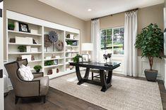 Built-in shelving + subtle area rug | Holbrook model home study | Parker, Colorado | Richmond American Homes Industrial Office Design, Modern Office Design, Office Interior Design, Office Interiors, Richmond Homes, Richmond American Homes, Commercial Office Design, Kb Homes, Solid Wood Desk