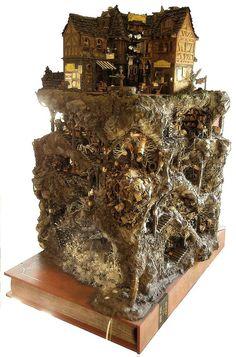 """Das Modell der Katakomben von Buchhaim (in Anlehnung an Walter Moers Roman """"Die Stadt der träumenden Bücher"""") stellt wohl das mit Abstand wahnwitzigste meiner Projekte dar. Es handelt sich hierbei um eine Darstellung der Buchhaimer Katakomben, die sich - querschnitsartig wie bei einer Ameisenfarm - kreuz und quer durch einen großen Block von Felsen und Erdreich ziehen, wobei auch einige der Hauptsettings (die lederne Grotte, der Kristallgarten und die Müllhalde Unhaim) dargestellt s..."""