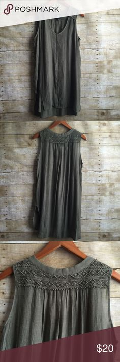 Army Green Tunic In new condition.  Worn once. Beautiful details on shoulders and upper back!  Thin and light.  Slits up both sides. Love this color green!! Fits up to large bobeau Tops Tunics