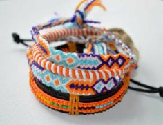 1 leather bracelets, 1 round design, & 2 friendship bracelets orange colour