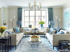 A pair of Hampton sofas by Dennis Miller Associates, upholstered in Holly Hunt's Strata, and two Allure lounge chairs by Nancy Corzine have clean, horizontal lines that suit the living room's midcentury­-modern vibe. Madeline Stuart nesting tables from Jerry Pair. Curtains in Lee Jofa's Glazed Silk. Tangiers Tile rug by Patterson Flynn Martin. Garrison pendant from the Urban Electric Co.