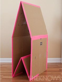A DIY collapsible cardboard playhouse could make a quiet reading nook in your… Cardboard Playhouse, Diy Playhouse, Cardboard Crafts, Cardboard Houses, Diy Cardboard Furniture, Kids Furniture, Furniture Design, Plywood Furniture, Fireplace Furniture