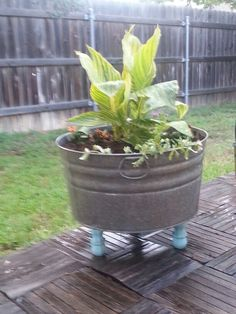 Old washtub + 3 legs + spray paint and a drill - awesome planter