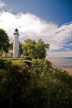 Pointe Aux Barques Lighthouse is 89 feet tall with 103 cast iron steps to the top. The lighthouse has a flashing white light that shines 18 miles out over Lake Huron. Lighthouse Lighting, Lighthouse Photos, Saint Mathieu, Lake Huron, Beacon Of Light, Am Meer, Great Lakes, Places To See, Michigan