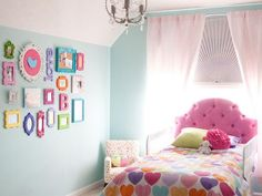 Cheap or dollar store picture frames spray painted brightly coloured colours make fir a fantastic feature wall.