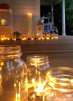 Decorating our Victorian front porch for Halloween... line your steps and walkway with mason jars and battery-powered tea lights.