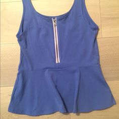Express top Brand new with tags. Cute express top perfect for throwing with a jacket for work or by itself for going out at night. Express Tops Tank Tops