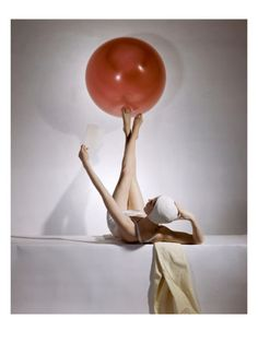 "Horst P Horst was a fashion photographer who made his mark in the 1940's. He changed the way that fashion was photographed. This photo was later turned into a vogue cover where the ball was used at the ""o."" His style is what lead to the way we see fashion photographed today."