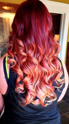 Apollymi's hair is a mix between all ranges reds, yellows, blacks, oranges, and occassionally white