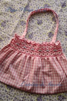 Smocking embroidery of small Granny bag--at least that was the translation.  Smocking on checks is older than I am!!!  Treat it like counter smocking.
