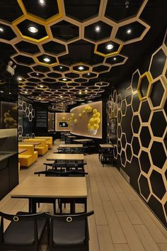 Irregular hexagons are distributed throughout the 'rice home' restaurant located in guangzhou city, china by hong kong company AS design. a dynamic interior reflects the newly launched casual dining brand that emphasizes on unique and contemporary recipes that are creatively blended with modern and innovative approach. #restaurantdesign