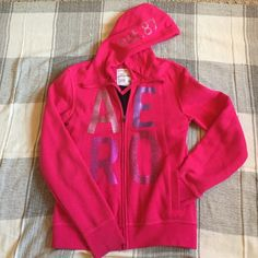 Aeropostale Pink Hoodie This hoodie is brand new, never used. It is very comfortable and has a cozy inner lining. Two inside pockets and two pockets on the front, plus cute details on the hood and front. Large but fits medium well  too. Aeropostale Jackets & Coats