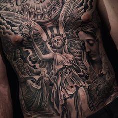 angel tattoo on stomach