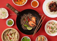 Buy Assorted Chinese dishes by its_al_dente on PhotoDune. Big wok pan with noodles and shrimps with assortment of Chinese dishes and snacks: sweet and sour chicken, dumplings,. Sweet N Sour Chicken, Asian Recipes, Ethnic Recipes, Spring Rolls, Dim Sum, Dumplings, Wok, Stir Fry, Fries