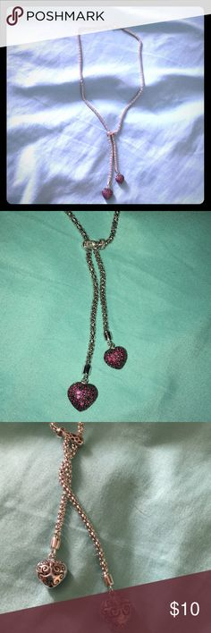 Double heart necklace Super cute double heart necklace with pink-ish purple gems! Don't know where it came from or if it's real I never wear it so I want to get rid of it! Jewelry Necklaces