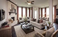 Natural wood furniture and Earth tones combine in this relaxing living room. Grand Mission Estates 50s // Richmond, TX // Plan 539 // Highland Homes