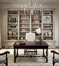 A formal home office with built ins that make this space feel grand.