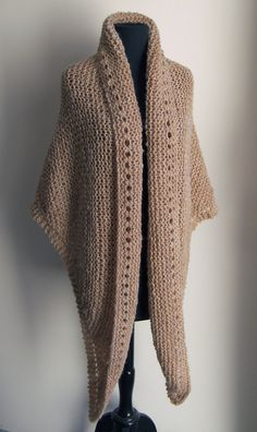 This toasty warm and comfy shawl is made from soft brushed acrylic blend yarn in neutral tan blush heather. It is a light, warm, versatile, practical garment. Use it for prayer, meditation, reflection, and to comfort neck and shoulders. Wraps easily around you for a warm hug. Can be used as a bed jacket. Optional long tie cord included.  This shawl is made from a soft acrylic blend yarn with that wears comfortably against your skin. Made in a smoke-free, fragrance-free and pet-free…