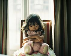 A girl and her teddy