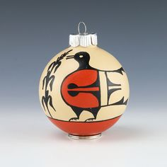 "Kewa potter, Ryland Bailon hand crafted this lovely bird ornament.  This is a glass ornament that is hand painted with traditional pottery designs and colors.  A unique addition to your ornament or Native American art collections.   3  1/4"" tall x 2  1/2″ long x 2  1/2″ wide  Artist card included Bird Ornaments, Handmade Ornaments, Artist Card, Pottery Designs, Native American Art, Nativity, Christmas Bulbs, Hand Painted, Traditional"