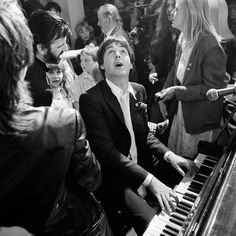 Paul McCartney playing piano at Ringo Starr's wedding