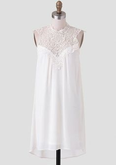 This breathtaking ivory chiffon dress is the perfect addition to any occasion.