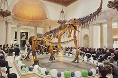 Ceremony with dinosaurs at the natural history museum -- Pinning this for general awesomeness and a couple of ideas I wouldn't mind swiping!