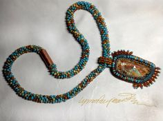A one of a Kind made one bead at a time ... Nevada by LynnParpard