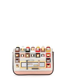 Fendi calfskin and dyed calf hair (Italy) baguette. Multicolor ABS studding on flap top. Removable leather crossbody strap. Mixed metal Fendi buckle secures turn-lock closure. Inside: fabric lining; o