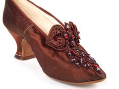 1880-90s Brick color satin shoes, decorated with a bow, beading and large false rubies on the vamp.