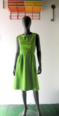 Someone please buy this, so I don't feel compelled to. (60s Mad Men dress - apple green shantung - Carol Craig designer dress - Megan Draper chic - size 6/8. $90.00, via Etsy.)