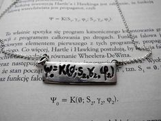 Hartle-Hawking state  Silver pendant with a famous equation, that helps count the probability of a universe's creation out of nothingness. And it