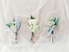Simple sweet white and grey greenery boutonnières Photography: Rachel Solomon - www.rachel-solomon.com Read More: http://www.stylemepretty.com/2015/06/09/al-fresco-arizona-garden-wedding/