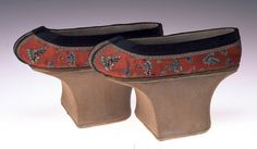 Manchu Woman's Shoes  Unknown Artist  circa 1875-1900 Red silk satin embroidered with multicolored silk, with ribbon Chinese overall: H. 14.8 x W. 22.4 cm; H. 5 13/16 x W. 8 13/16 in MWCH66:5  Murray Warner Collection of Oriental Art