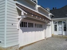 1000 images about for the garage on pinterest garage doors garage and diy trellis for How to build a roof overhang over an exterior door