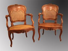 Pair of #caned armchairs #LouisXV stamped by #Parmentier (Lyon) for Nicolas Parmentier. Bulged legs with decor of flowers, fiddle-back also carved with flowers. Work from Lyon. #18th century. For sale on Proantic Galerie Pellat de Villedon.