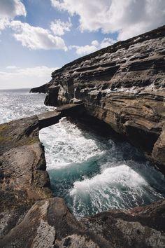 Oahu's Unreal Coastline    http://www.unrealhawaii.com/2013/02/oahu-rock-bridge-and-sea-cliffs/