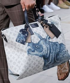 For Spring 2017, Louis Vuitton Took Its Men's Bags on a Fantastical Storybook Safari