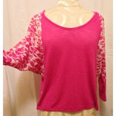PINK CHEETAH SHEER BATWING BURNOUT TSHIRT NWT. Never worn, no flaws. Cute pink burnout tee with sheer cheetah pattern. Cuffs of sleeves are fitted and can be rolled or pushed up. Batwing style sleeves. Really cute and comfy! No trades or PayPal. Please view photos and ask questions before purchasing. Thanks!!! Size medium. Eyecandy Tops