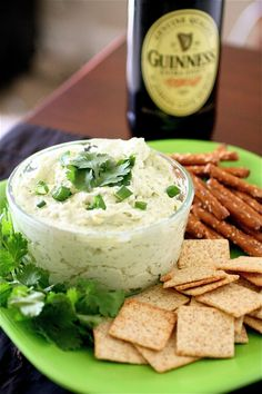 Guiness dip. Gotta make for hubby. 8 ounces cream cheese, softened 2 and 1/2 cups sharp cheddar cheese, grated 1 teaspoon Dijon mustard 2 tablespoons half-and-half 1/4 cup Guinness 2 or 3 scallions, chopped 1 teaspoon garlic, minced 2 tablespoons parsley, chopped Sea salt and pepper, to taste