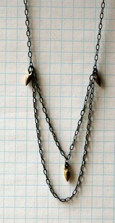 Oxidized Sterling Silver Chain and Brass Spikes - Pigeon Toe Necklace (Short). $38.00, via Etsy.