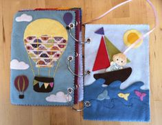 Quiet book with a doll on a ribbon that can camp, ride in airballoon and boat, etc